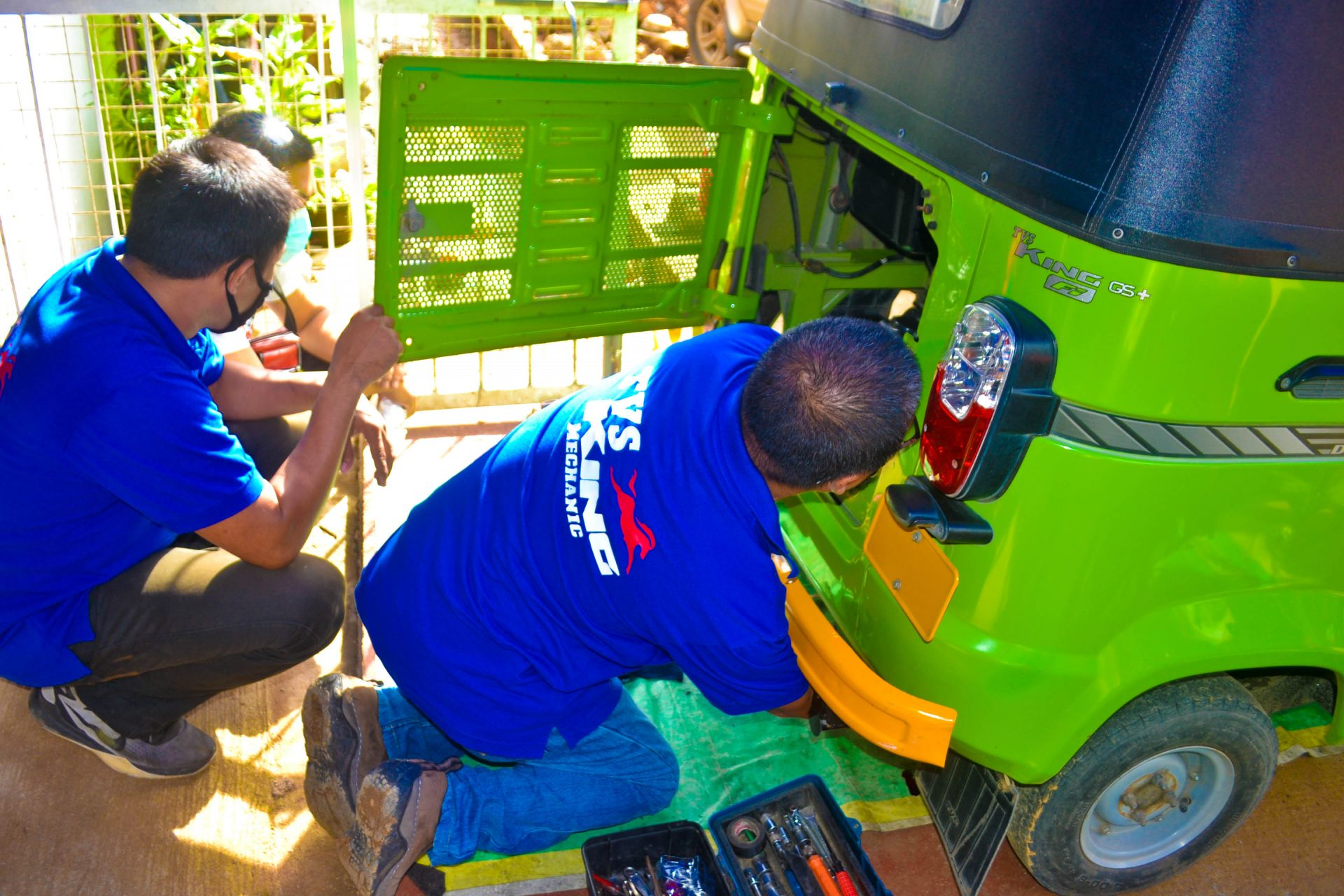 Willie and Dennis Servicing a TVS King
